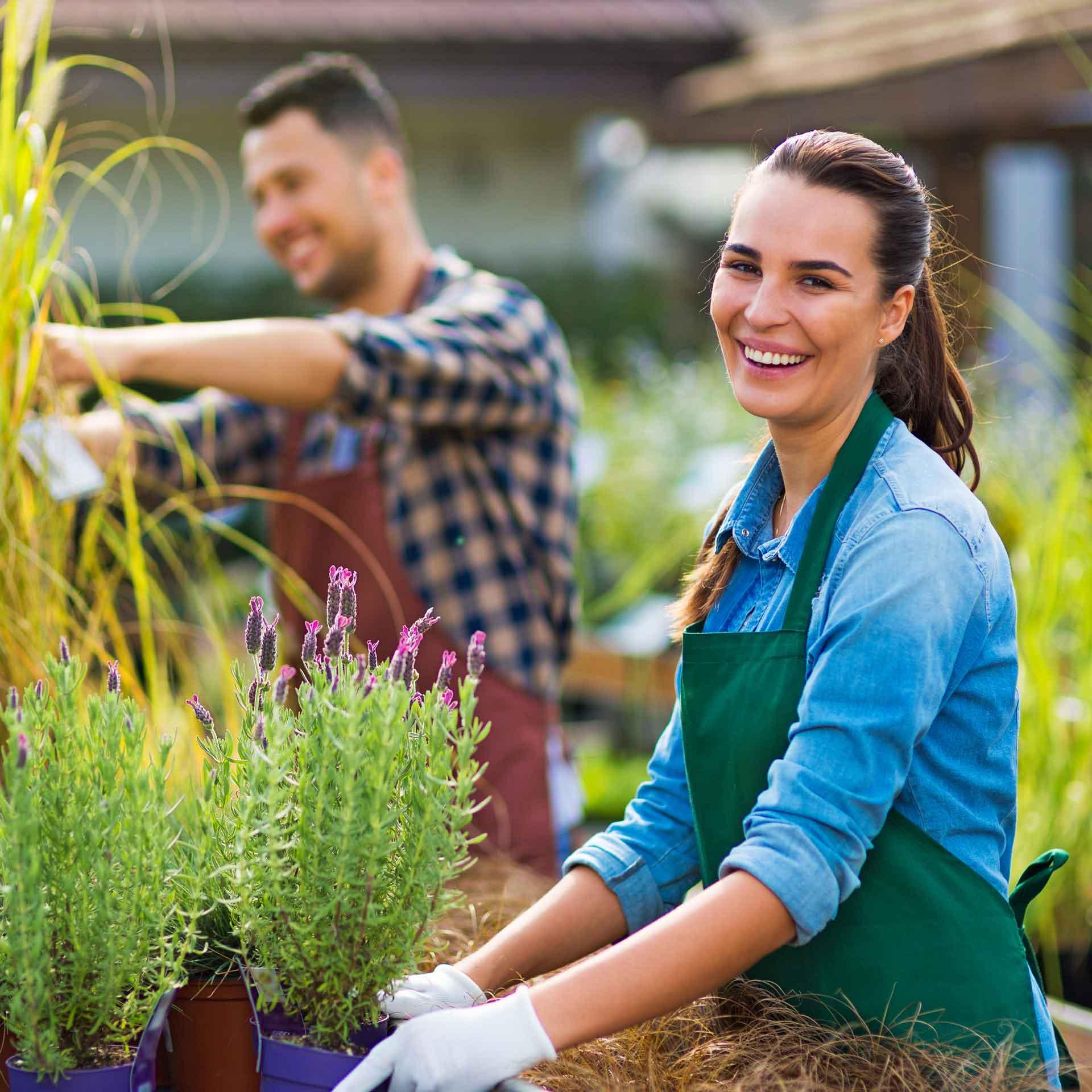 female garden center employee working